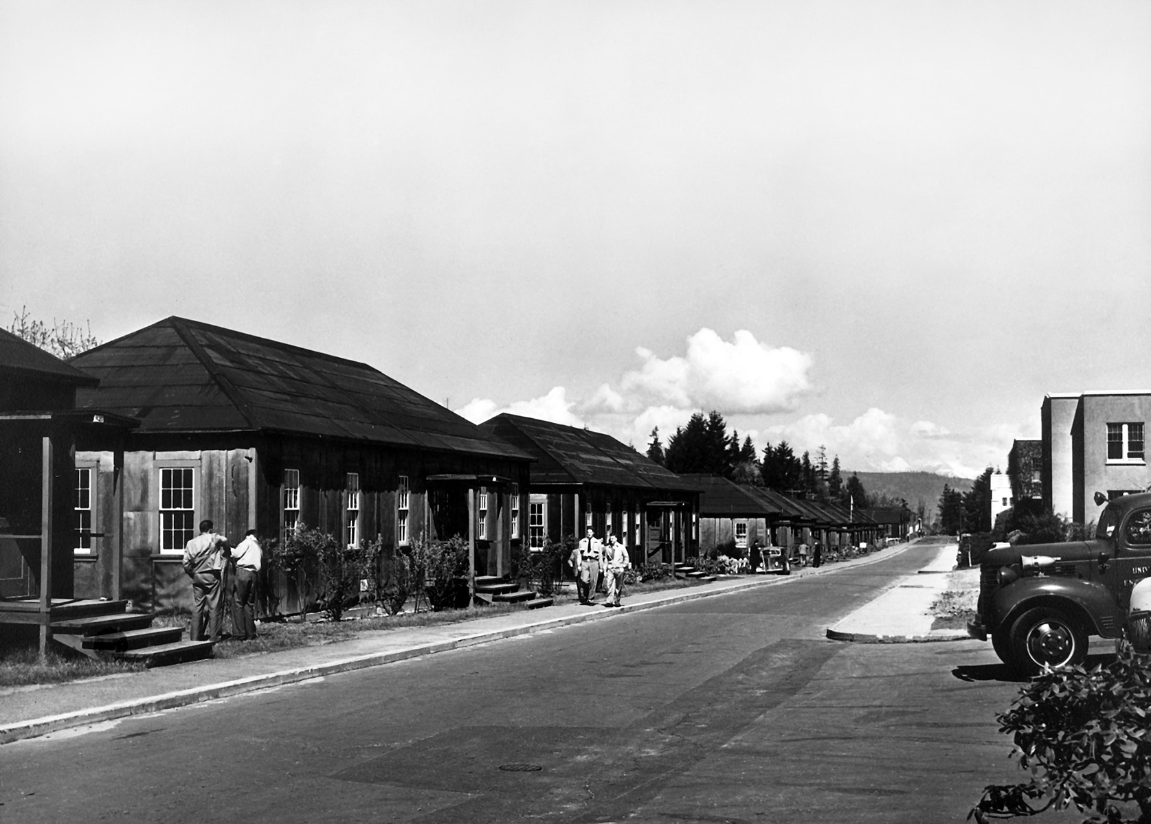 Trucks moving army huts into place on West Mall, Vancouver, 1946.
